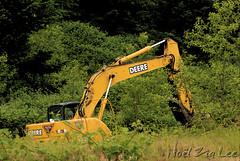 Oh nooooo!! (Nol Zia Lee) Tags: nature progress civilization wilderness excavator postprocessing imagenomicsnoisewaresharpenedandfilteredoutnoise lensnikonafsvrzoomnikkor70300mmf4556gifed paintshopprophotox2croppedandadjustedbrightnessandcolor anotherbitofnaturebitesthedust