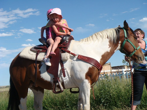 Nikki and Lexi on the horse.