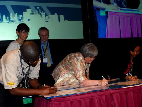 Leslie Lewis signs the Toronto Declaration