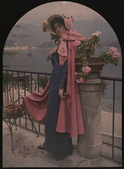 Woman in pink cape and bonnet (George Eastman House) Tags: pink flowers woman hat fashion standing costume dress purple cape bonnet georgeeastmanhouse autochrome photo:process=colorscreenplateautochrome color:rgb_avg=574844 geh:accession=197708460001