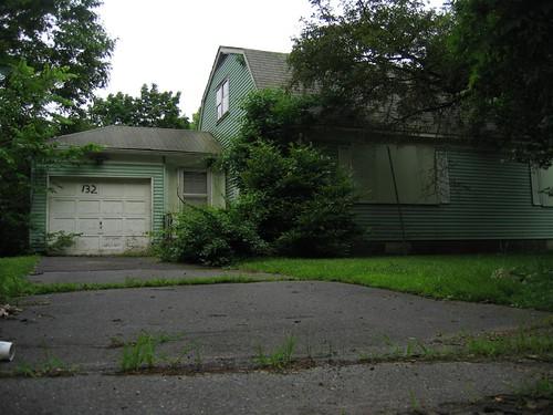 Yet another overgrown, empty home