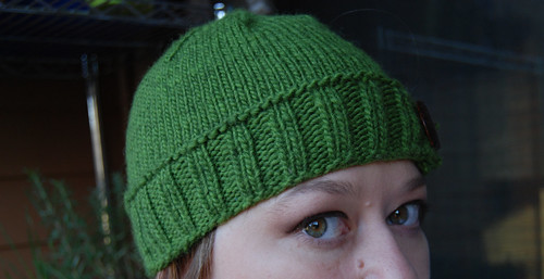 side of green hat
