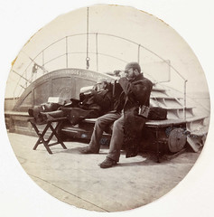 Two men on the deck of a ship (National Media Museum) Tags: ocean voyage wood travel sea sign stairs circle kodak coat watching working victorian deck binoculars lazy sideburns leisure sailor steamboat pinstripe packages footstool steampunk paddlesteamer nationalmediamuseum allowedonthebridgegoinginorout