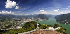Lago di Lugano from San Salvatore (Pavel Vanik) Tags: panorama lake mountains church nature clouds canon lago eos schweiz switzerland tessin see ticino suisse swiss lac di svizzera lugano 30d sansalvatore 1755is lake lago lugano lugano