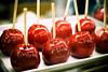 candy apple reflections (raspberrytart) Tags: red food utah interestingness yummy nikon candy sticky explore delicious sweets interestingness9 toffeeapples candiedapples utahstatefair d80 seenonexplore capturemyutah