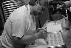 Herb making cookies (eedgejr) Tags: new york city nyc blackandwhite bw newyork halloween cookies nikon manhattan documentary bakery historical d200 uppereastside glasers magnumworkshop uppsereast