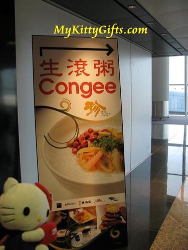 Hello Kitty at Hong Kong Airport enjoying Congee