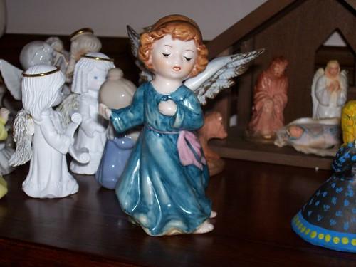 Adoring angel in dark blue