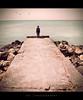 how deeply i need you (alvin lamucho ©) Tags: ocean morning boy sea seagulls photoshop vintage concrete rocks path stones son symmetry cracks vignette pathway lightroom agedtone