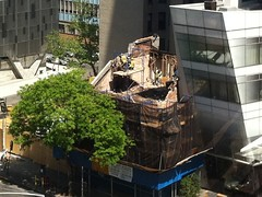 Workers tearing down 35 Cooper Square