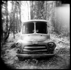 Old Mail Van (KurtClark) Tags: blackandwhite backlight newcastle washington holga lomo mail decay lightleak abandon wa dodge backlit van ilforddelta3200