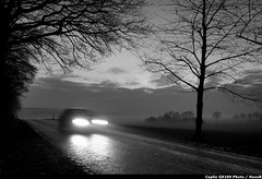 A sort of homecoming (Hans van Reenen) Tags: road blackandwhite bw car germany u2 deutschland mood noiretblanc fav50 availablelight fav20 fav30 atmosfera underway borderline niederrhein arbolitos fav10 kranenburg fav100 grafwegen fav40 grafwegenerstrasse fav60 fav110 fav90 fav80 fav70 gx100 fav120 asortofhomecoming 20071223 ricohcapliogx100