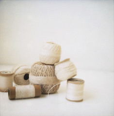 threadfrompcc (danske) Tags: stilllife white thread spools polaroid beige stuff ecru neutrals