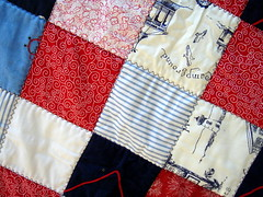 detail of red blue patchwork quilt
