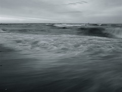 Surge and Flow (robert_goulet) Tags: blackandwhite bw lake ontario canada fall beach water weather contrast flow grey soft waves pattern natural tide hamilton windy olympus monotone receding flowing lakeontario wavy surge zuiko recede crashing evolt e500 zd fourthirds 1454mm mikecrough