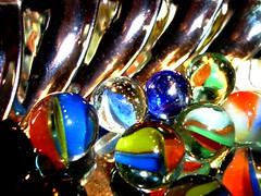 Colors (Elanorya) Tags: colors luci colori oggetti acciaio biglie