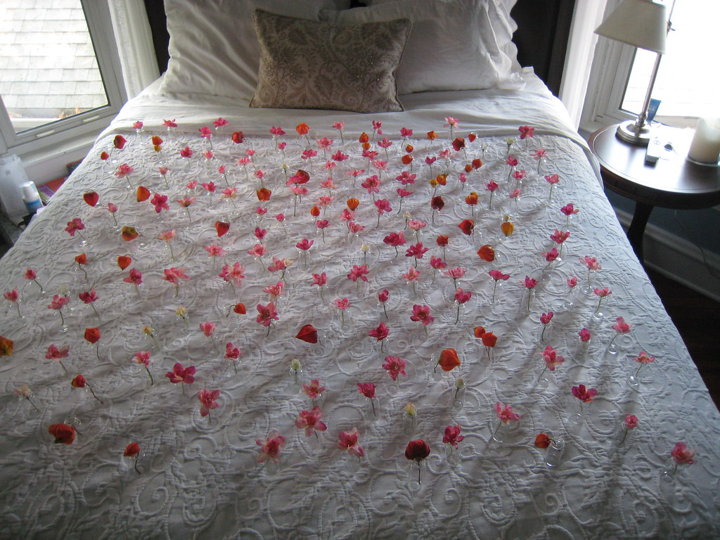 After Katie and Paul's wedding - 1,000 flower petals in vases on the bed