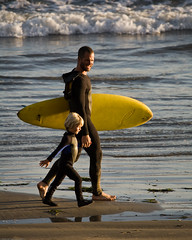 "Father and son surf lesson in Morro Bay, CA - image by Michael ""Mike"" L. Baird (mikebaird) Tags: beach water rock walking bay kid sand surf friendship father son creativecommons surfboard era morrobay lesson sales youngster morro income morrorock growingup abuse wetsuit bonding grom revenue thecoast myshowcase surflesson 30nov2008 evolutionofdadcom evolutionofdad wwwadventureparentscom adventureparents"