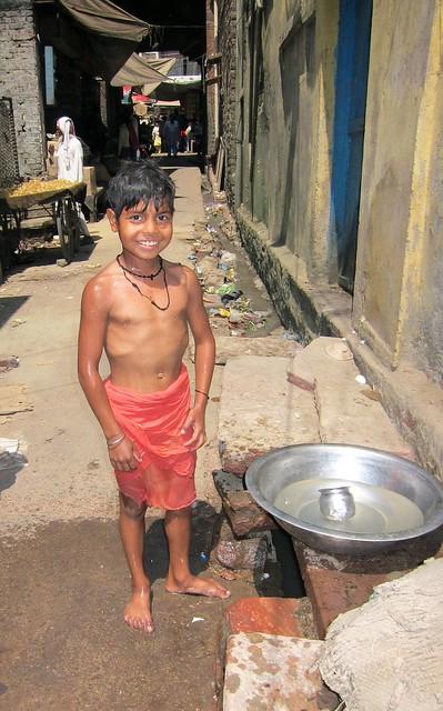 Boy Taking A Rinse