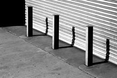 (Delay Tactics) Tags: street bw white 3 black three shadows sheffield shutter bollards rockingham