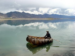 Leather Boat on a Lake in Tibet (Namisan) Tags: blue yak lake water leather river boat tibet tibetan outstandingshots leatherboat