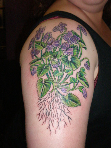 violet flower tattoo. Violets are the flower for