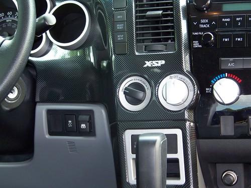 Carbon fiber dash close-up.
