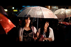 Horizontals: Rainy night in Harajuku (manganite) Tags: girls people color topf25 beautiful beauty fashion japan night digital umbrella dark walking geotagged asian japanese tokyo cool topf50 nikon women colorful asia pretty tl framed candid young teens style streetscene babes harajuku teenager  nippon  d200 nikkor dslr gals umbrellas raining nihon kanto streetscenes stylish japanesegirl 50mmf18 utatafeature manganite nikonstunninggallery ipernity diamondclassphotographer flickrdiamond date:year=2006 geo:lat=35669752 date:month=september date:day=17 geo:lon=13970313 format:orientation=landscape format:ratio=21
