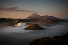 volcanos in the mist (sgoralnick) Tags: travel vacation sunrise indonesia landscape volcano java asia southeastasia smoking bromo mountbromo eastjava gunungbromo tenggersemerunationalpark