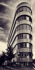 Our Flatiron (Philipp Klinger Photography) Tags: windows sky white house black tree glass metal sepia architecture clouds reflections germany deutschland hessen frankfurt philipp flatiron hesse klinger dcdead