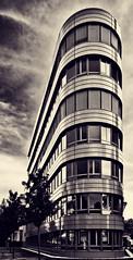 Our Flatiron (Philipp Klinger Photography) Tags: windows sky white house black tree glass metal sepia architecture clouds reflections germany deutschland hessen frankfurt philipp flatiron hesse klinger dcdead