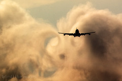 Commercial plane passing through clouds and wake turbulence (Greg Bajor) Tags: uk vortex london weather clouds plane airplane flying airport heathrow aviation united flight kingdom aeroplane landing swirl boeing approach 747 chasing descending wingtipvortices gregbajor