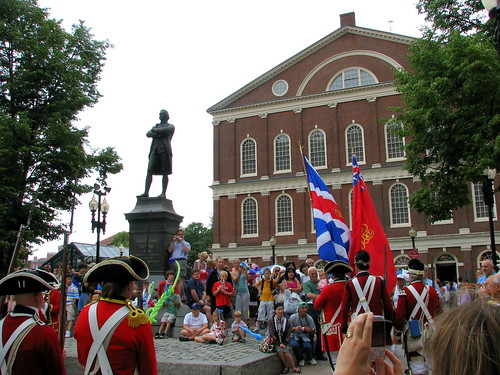Red Coats in front of Quency Market
