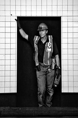 4114a (Mike Dillingham) Tags: nyc portrait blackandwhite bw newyork man train canon subway eos manhattan candid tracks july tiles frame rails mta worker gothamist 2008 leaning inset saftey canonefs1755mmf28isusm 40d