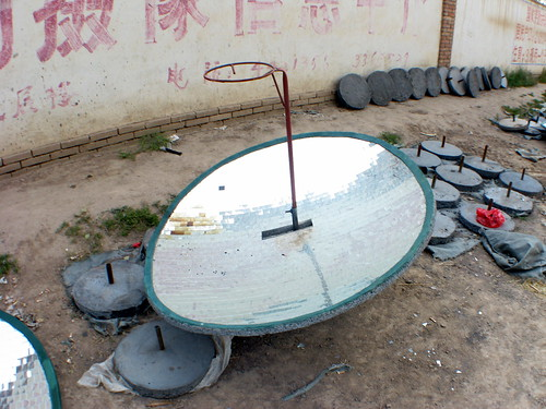 Solar cookers being assembled near Minlou, Gansu Province, China