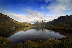 Colours of Cradle Mountain (markdanielowen) Tags: park blue trees winter cloud mountain snow mountains cold reflection green water rain clouds nationalpark rainbow rocks australia tourist national tasmania hobart tas tassie launceston cradle cradlemountain