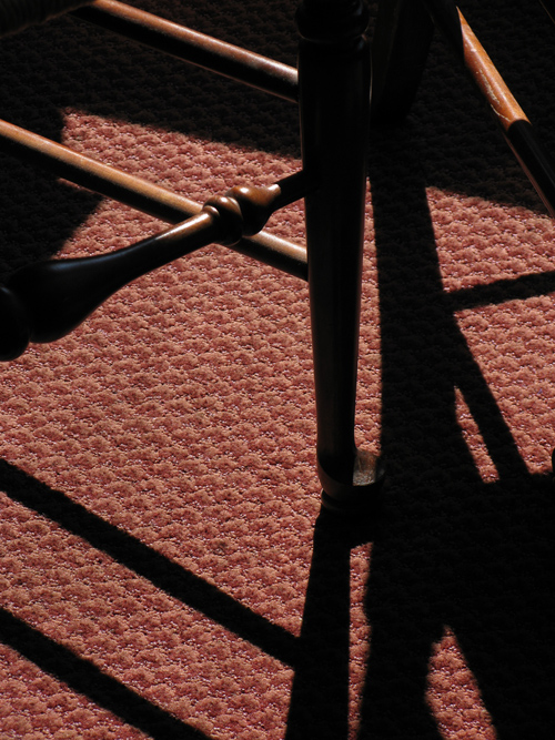 shadow from a table and chairs