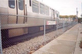 Outbound Chicago Transit Authority Brown line train leaving the Kimball Avenue terminal. Chicago Illinois. October 2003.