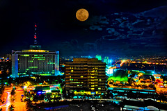Full Moon Rises over Ortigas (Vic de Vera) Tags: street city travel blue sky moon building cars colors beautiful beauty skyline night clouds buildings photography lights photo interesting power view nightshot image country philippines citylife fullmoon explore planet destination lopez hdr pp appeal ortigas meralco ortigasavenue aplusphoto meralcobuilding vicdevera