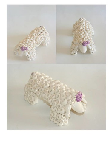 white ceramic sheep with purple flower