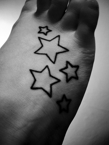 heart tattoos for women on foot. foot star tattoos women