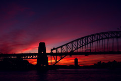 The Climax (Deshi Knaves) Tags: bridge pink sunset red sky orange water canon harbor 28mm sydney ef climax 400d shoulette