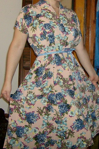 Soft, gorgeous flowing rayon.  This dress is a tad big, and needs some hem repair and a belt.