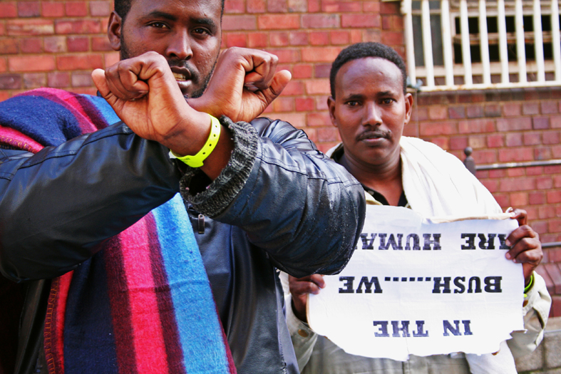 2 Somali men with sign