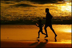 Dad (garyclicks) Tags: travel light sunset shadow wallpaper favorite beach nature beautiful night poster daddy fun gold evening kid colorful dad play father goa daughter scenic running run palmtrees jogging jog beachsunset beautifulsunset beautifulevening indianbeach colorfulclouds photoaward colorphotoaward sunsetwallpaper wallpapersunset goanheritage thegoanheritageindia wallpapertravelbeachwaterpeople
