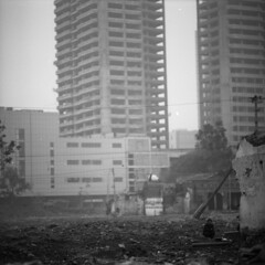 how we were (memetic) Tags: china street bw man 6x6 buildings asian uncut blackwhite sitting tmax chinese demolition 100  vanishing tianjin rubble  arax60 disappearing autaut