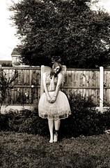 Shy (evilibby) Tags: girl sepia garden wings shy fairy human libby tulle tutu faerie fairie
