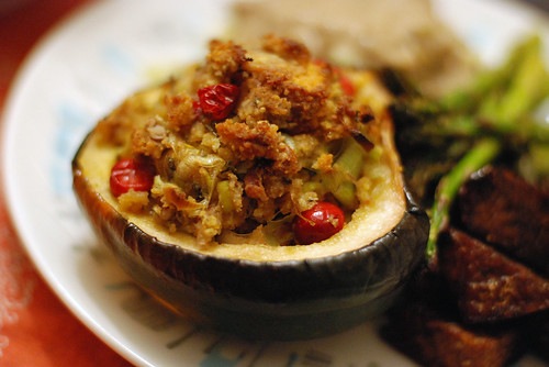 acorn squash stuffed with cranberry, pecan, leek, and sage cornbread stuffing.