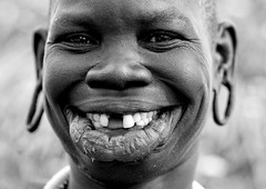 A Surma smile Ethiopia (Eric Lafforgue) Tags: africa portrait woman smile happy artistic dam tribal lips ornament ear tribes afrika lip bodypainting ethiopia tribe ethnic rite surma barrage tribo indigenous adornment pigments indigenouspeople tribu omo eastafrica thiopien etiopia ethiopie etiopa 3458 tribalgirl lafforgue  indegenous etiopija ethiopi  etiopien etipia  etiyopya  nomadicpeople lipplates   tribalgirls    salinicostruttori    gibeiiidam gibe3dam bienvenuedansmatribu peoplesoftheomovalley