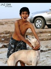 bu3abd the friend of all animals !!   (Jaz Q6r) Tags: boy sea dog kide   jazq6r  bo3abed